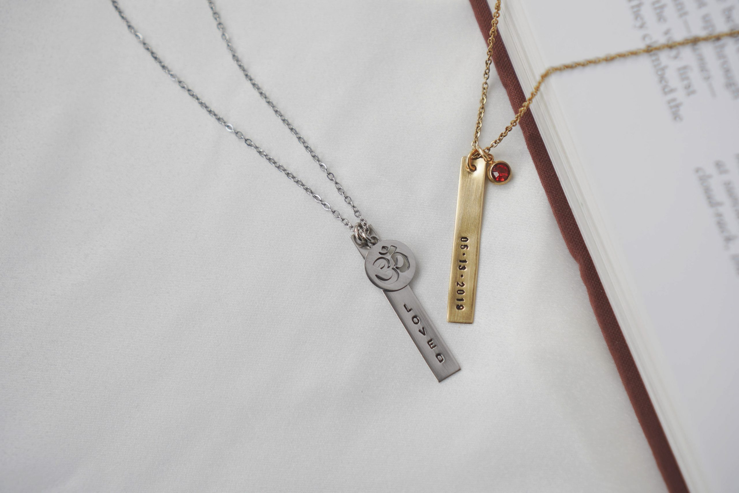 Catalina Bar Necklace in 18K Gold with Birthstone and White Gold with OM Charm